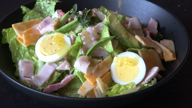 healthy cobb salad with creamy vinaigrette dressing - cobb salad stock videos & royalty-free footage
