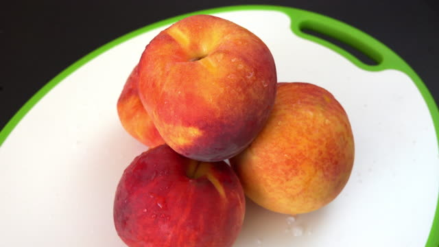 Healthy eating: fresh peaches on a cutting board slowly turning