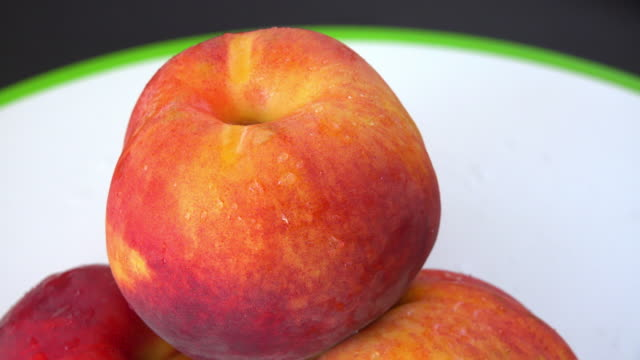 healthy eating: fresh peaches on a cutting board slowly turning - peach stock videos & royalty-free footage