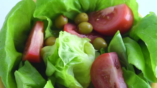 healthy eating: preparation of a boston lettuce based salad - bowl stock videos and b-roll footage