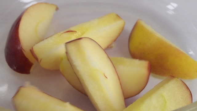 vidéos et rushes de healthy food: apple slices falling in slow motion - vue partielle