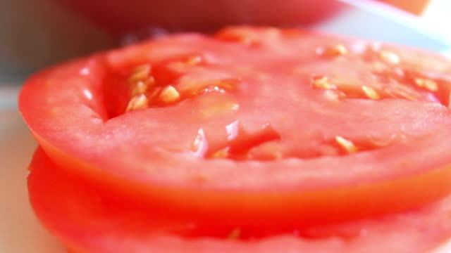 healthy food: cutting slices of tomato - chopped food stock videos and b-roll footage
