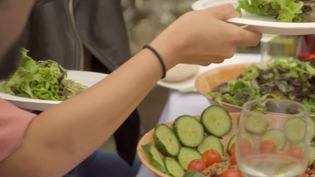 healthy food is served at a party. - paper plate stock videos & royalty-free footage