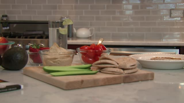 wgn healthy food on a kitchen island on june 2 2016 - kitchen worktop stock videos & royalty-free footage