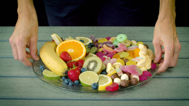 healthy fruit and unhealthy candy eatting habits - sweet food stock videos & royalty-free footage