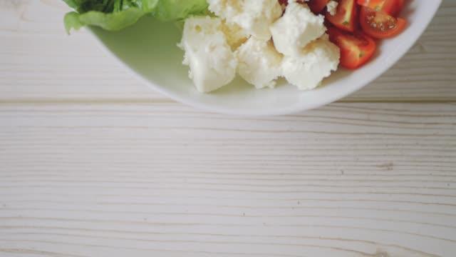 healthy green lentil bowl with feta cubes - feta stock videos & royalty-free footage