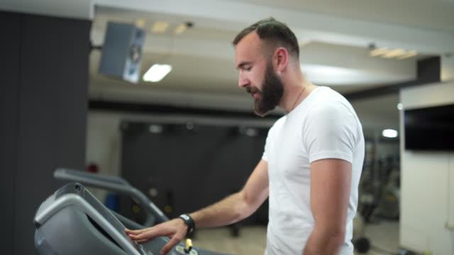 healthy man running on treadmill - treadmill stock videos & royalty-free footage
