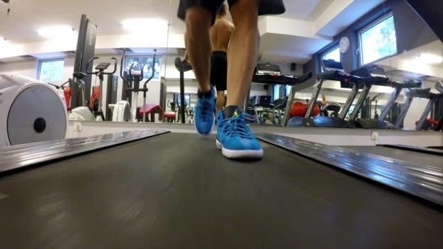 healthy man running on treadmill - human limb stock videos & royalty-free footage