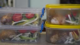 Healthy meal prep containers with chicken and vegetables
