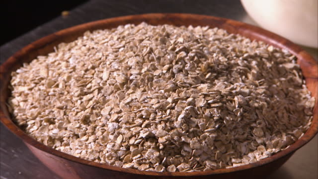 healthy oats on a bowl - oatmeal stock videos & royalty-free footage