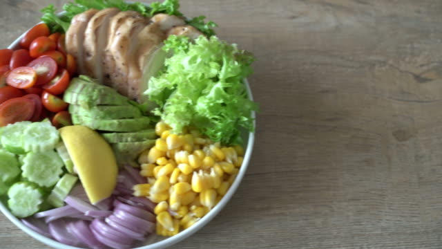 healthy salad bowl with chicken breast - bowl stock videos and b-roll footage