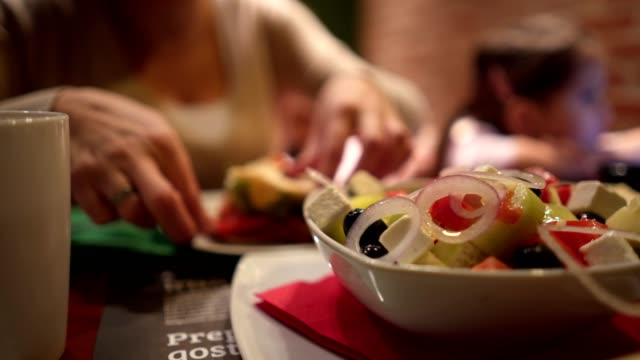healthy salad in restaurant eating by mother and daughter - obscured face stock videos & royalty-free footage