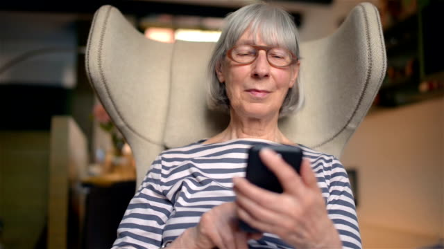 healthy senior woman typing a message - real people stock videos & royalty-free footage