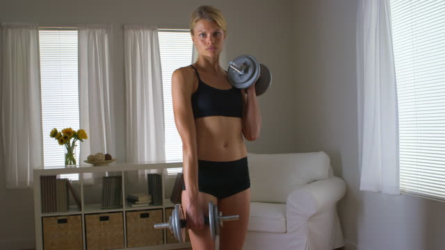 Healthy woman holding weights