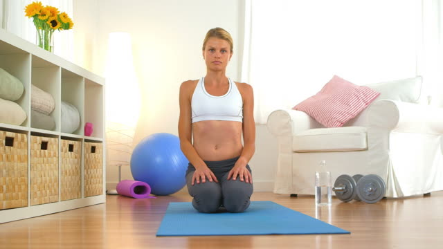 Healthy woman resting after workout