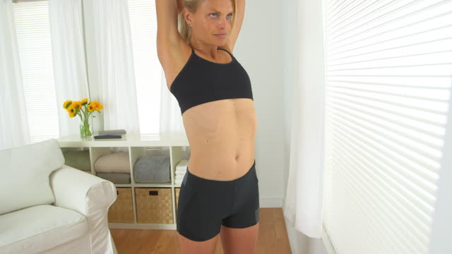 healthy woman stretching arms before workout