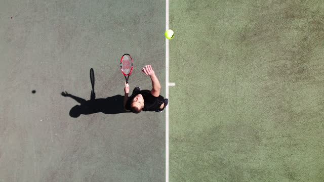 a healthy young man playing tennis from directly above - sports training stock videos & royalty-free footage