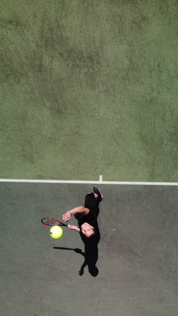 a healthy young man playing tennis from directly above - one young man only stock videos & royalty-free footage