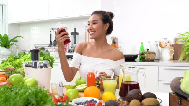 healthy young woman drinking juice - detox stock videos & royalty-free footage