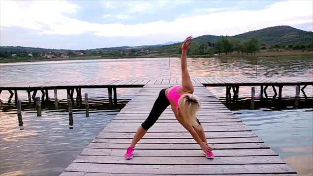 Healthy young woman warming up outdoors