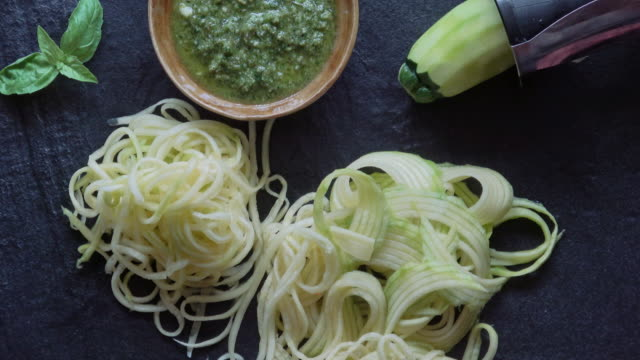 healthy zucchini noodles with pesto - courgette stock videos and b-roll footage