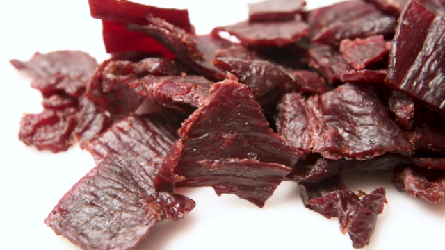 heap of beef jerky close up - part of stock videos & royalty-free footage
