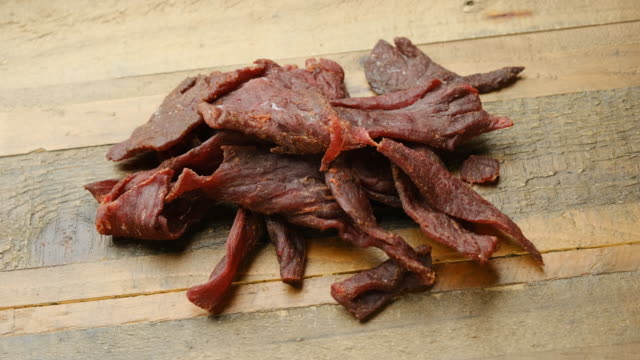 heap of beef jerky close up - beef stock videos & royalty-free footage