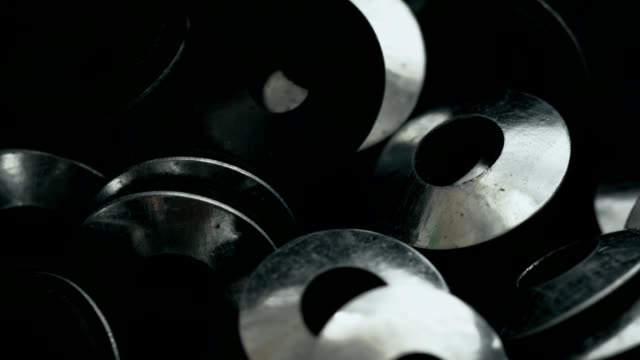 Heap of flat washers with rubber gaskets