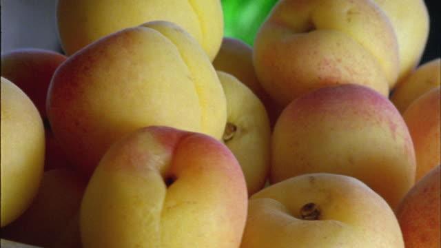 ECU,  Heap of fresh apricot rotating