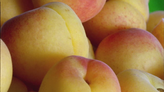 ecu, heap of fresh apricot rotating - apricot stock videos & royalty-free footage