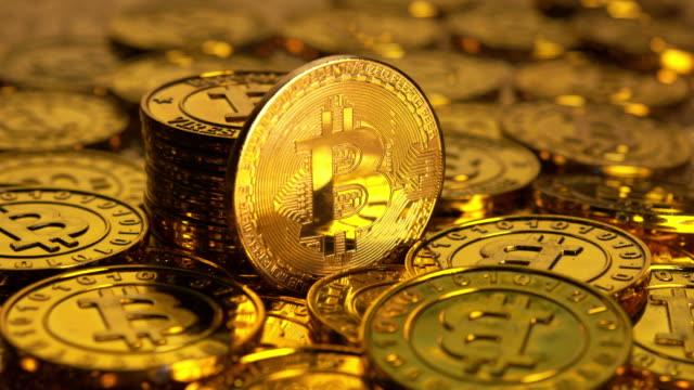 Heap of golden bitcoins Bitcoin is a worldwide digital currency that isn't controlled by a central authority such as a government or bank