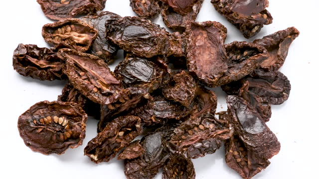 heap of organic sun dried tomatoes from above - dried food stock videos & royalty-free footage