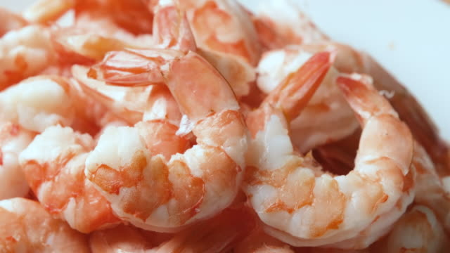 heap of peeled cooked shrimps - decapitated stock videos & royalty-free footage