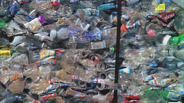 cu pan heap of recycled plastic bottles, santa barbara, california, usa  - bottiglia video stock e b–roll