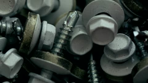 heap of white screws with rubber gaskets and flat washers - grey colour stock videos & royalty-free footage