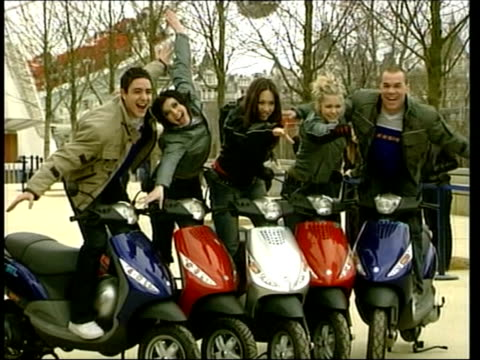 stockvideo's en b-roll-footage met kim marsh leaving rumours itn hear'say band members posing for photocall with scooters - 2002