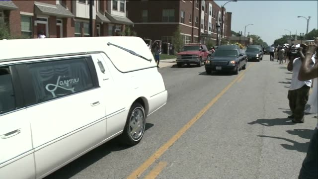 a hearse and cars drive by in procession after michael brown's funeral on august 25 2014 in st louis missouri - hearse stock videos & royalty-free footage