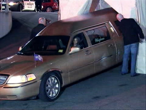 hearse arrives in back of funeral parlor backing hearse into tent. there is a medium shot of the hearse arriving at the back of the funeral parlor.... - platinum stock-videos und b-roll-filmmaterial
