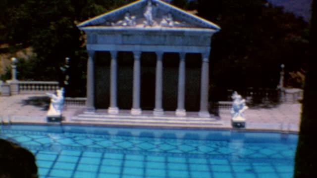 vídeos y material grabado en eventos de stock de hearst castle tour guide / neptune pool / casa grande / indoor pool / hearst castle at historical landmark on june 01 1974 in san simeon california - 1974