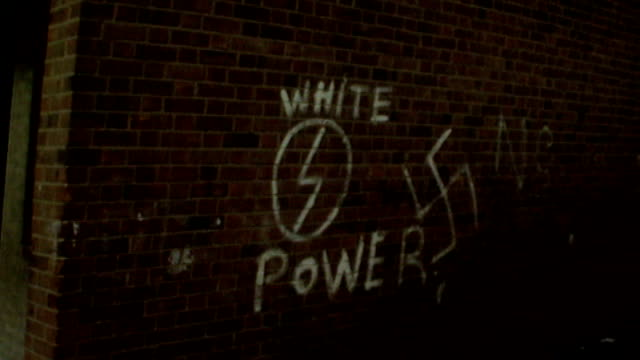 heart disease pill linked to reduction in subconscious racism; tx.17.3.81 'white power' and nazi swastiko graffiti on wall tx 30.1971 swastika... - nazi swastika stock videos & royalty-free footage
