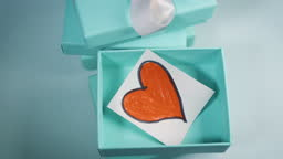 Heart drawn inside a turquoise gift box