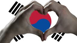 Heart Hand Sign and Flag of South Korea.
