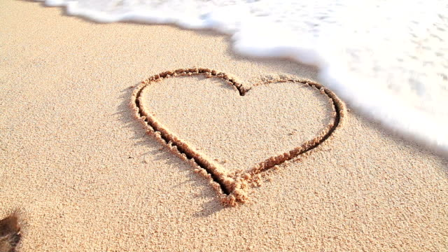 heart on the sandy beach deleted by ocean - symbol stock videos & royalty-free footage