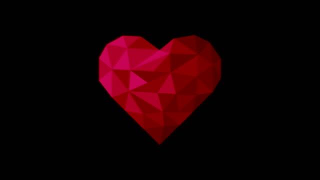 vídeos de stock, filmes e b-roll de coração poli da cor vermelha - articulação facetária