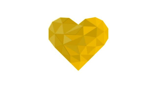 vídeos de stock, filmes e b-roll de coração poli da cor amarela no backgr. und branco - articulação facetária