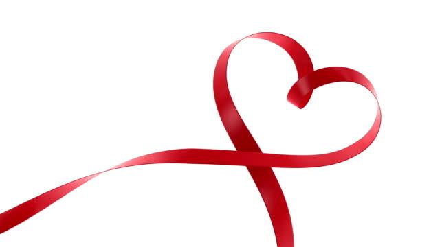 heart ribbon - ribbon sewing item stock videos & royalty-free footage