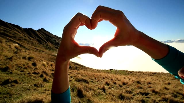 heart shape above the clouds - human finger video stock e b–roll