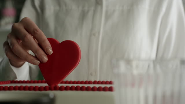 heart shape decoration - decorating a cake stock videos and b-roll footage