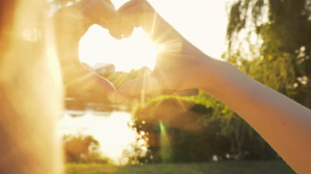 heart shape for the sun. - heart shape stock videos & royalty-free footage