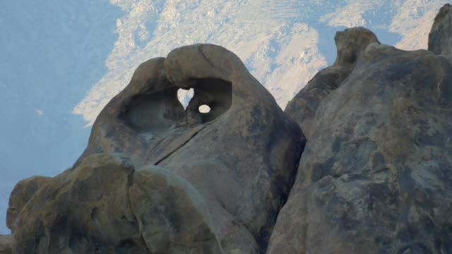 heart shape in boulder rock formation in mountainous desert. - boulder rock stock-videos und b-roll-filmmaterial